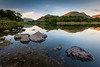 Sunrise at Ullswater #5, Lake District, North West England [Explored] (Anthony Lawlor) Tags: lakedistrict lake ullswater water reflections sunrise morning 4am mountains rocks reflection blue green light still tranquil calm mindful mindfulness