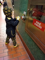 """""""I want to take a picture of everything first!"""" (quinn.anya) Tags: sam preschooler photography camera batman captain streetphotography bart fireextinguisher"""