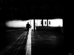A new day, a new chance (René Mollet) Tags: man street streetphotography shadow silhouette streetart streetphotographiebw blackandwhite bw basel backlight urban urbanstreet underground urbanlife candite monochromphotographie monchrom morning renémollet sundaylights