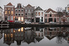 Still Working (McQuaide Photography) Tags: haarlem noordholland northholland netherlands nederland holland dutch europe sony a7riii ilce7rm3 7rm3 alpha mirrorless 1635mm sonyzeiss zeiss variotessar fullframe mcquaidephotography lightroom adobe photoshop tripod manfrotto light licht water reflection stad city urban waterside lowlight architecture outdoor outside waterfront building river spaarne riverside traditional authentic skyline house huizen residential winter longexposure calm still nopeople parkedcars old oldhouse dutcharchitecture