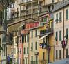 Slice of life, Riomaggiore, Italy (ms2thdr) Tags: cinqueterre europe italy liguria mediterranean riomaggiore town buildings shutters laundry colors