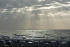 Sunbeams and beach huts (Jan van der Wolf) Tags: map14092v beach beachhuts strand light clouds wolken zonnestralen sunset sun sunbeams beams sea seascape seaside landscape landschap katwijk