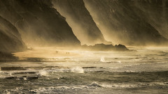 'Time and Tide' (Canadapt) Tags: cliffs beach surf fog mist ocean rocks sunset people panorama golden magoito portugal canadapt