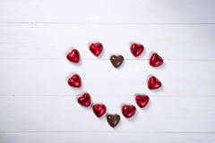 heart made of chocolates on white wooden background (lyule4ik) Tags: heart chocolate day sweet valentine love decoration holiday romantic shape symbol background gift joy red white wood wooden candy sugar cocoa delicious dessert fat food romance tasty affection artistic bokeh bottle bride card celebration composition concept confetti creative design effect family filter glass green happy life present retro rose shaped