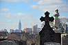 The Not So Eternal New York Skyline (Trish Mayo) Tags: calvarycemetery cemetery newyorkcityskyline empirestatebuilding gravestones cross monuments