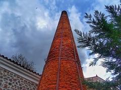 The old chimney..hotel Olivepress Molyvos village Lesvos Greece (panoskaralis) Tags: chimney factory hotel olivepress rusty red brike molyvos mithimna lesbos lesvosisland lesvos mytilene greece greek hellas hellenic outdoor