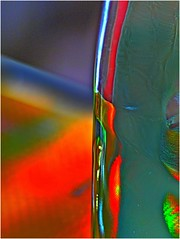 Abstract Bottle ! (jesse1dog) Tags: bottle bag reflections refractions rainbowcolours gm1 pentax110 70mm extensiontube desktop