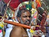 2009-02a Thaipusam Penang 2018 (69) (Matt Hahnewald) Tags: matthahnewaldphotography facingtheworld kavadi bearer dancer attam ceremonial sacrifice burden character head face eyes beard carrying consent respect travel culture religion vitality penance repentance virtue religious traditional cultural hindu hinduism murugan thaipusam festival celebration procession devotee georgetown littleindia penang malaysia asia tamil malaysianindian oneperson male adult man image photo nikond3100 primelens 50mm 4x3 horizontal street portrait closeup sidewaysglance outdoor color colorful authentic determined shoulder barechested middleaged twothirdview nikkorafs50mmf18g lookingcamera expression halflength