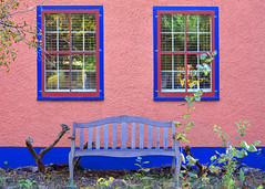 Unexpected colours (James_D_Images) Tags: house montana blue bench magenta pink wall window painted trim plants symmetry stucco wood flickr colours