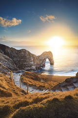 Durdle Door Sunset (tariqphoto) Tags: sunset durdle door winter 2018 january sony a7 zeiss loxia 21mm lee filters reverse nd polariser composite beach cove dorset purbeck estate lulworth landscape landscapes seascapes seascape blue arch alpha water england uk earth rocks travel travelling sky jurassic coastline coast coastal ocean dusk sun grass mirrorless cliff