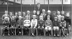 School photo (theirhistory) Tags: children boys kids girls teacher jacket dress shorts wellies shoes jumper boots class form school pupils students education