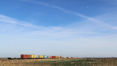 Under a big sky (Duck 1966) Tags: class66 freightliner containers train sky moon fenland cambridgeshire