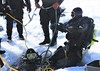 One in the hole, one on the hole (chemsuiter) Tags: lakesuperior divers icedivecertification rebreather ontheice munising hardwater