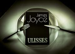 Devouring books (Sizun Eye) Tags: books devouring ulisses ulysses dinner fork knife plate read monochrome nb nikon d750 nikkor 50mm sizuneye stilllife dish