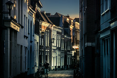 sunset street (bjdewagenaar) Tags: photography photograph photographer sony sonyalpha sonyphotographer sonyimages sonya77ii minolta minoltalens telelens minoltabeercan beercan gorinchem gorcum holland dutch city urban street streetphotography raw lightroom buildings architecture architecturephotography light shadows dark