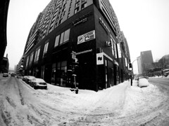 Corner of Peel and Ottawa in Winter (MassiveKontent) Tags: snow noiretblanc blackwhite montreal bw city monochrome urban blackandwhite streetphoto montréal quebec streetphotography bwphotography streetshot winter gopro fisheye corner