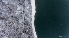 Split in half (Silvan Bachmann) Tags: switzerland swiss suisse schweiz schwyz lake water shore forest snow winter cold camera road nature landscape day drone dji phantom snowflakes above downwards cloudy