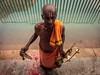 Musical Priest - Tirupati, India (Kartik Kumar S) Tags: tirupati kapilatheertham priest music pond pushkarni andhrapradesh india hinduism canon 600d
