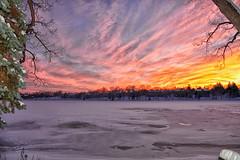 Sometimes frozen sunsets can be warm (paul.trottier) Tags: usa paultrottier colour beautiful arty colours colourful artistic photo art creative nikon d610 nikkor 28300mm lake barrington illinois winter ice snow
