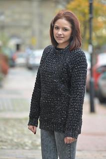 Girl in fisherman aran wool jumper