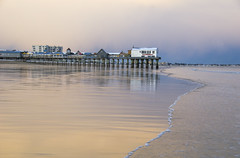 (amy20079) Tags: nikond5100 newengland maine oldorchardbeachpier sunset sea edge beach oldorchardbeach clouds waves reflections hotels offseason snow winter