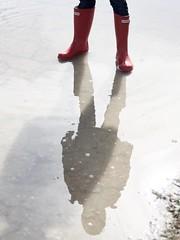 Shadow play (AriCatalán) Tags: 5yearoldkid boots kid niño botas silueta charco cuddle water agua reflejos sombra