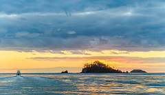 Sunrise Seascape with Island and Boat (Merrillie) Tags: daybreak landscape nature southcoast mountains boat water newsouthwales sea nsw sun batemansbay beach ocean australia waterscape scenery coastal island sunrise seascape dawn coast clouds snapperisland