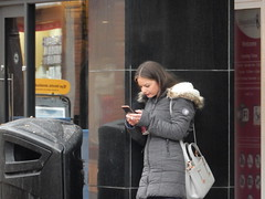 Mobile Girl (deltrems) Tags: blackpool lancashire fylde coast town centre people men women shoppers cigarette smoker mobile phone