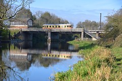 Swedish Y7 Railbus no. 1212 crosses the River Nene, with a service to Peterborough, fully loaded with a visiting coach party. 11 11 2017 (pnb511) Tags: nenevalleyrailway heritage trains lattice framework bridge water river