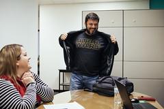 0110 Gary flashes his STAR WARS shirt at a meeting
