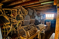 Traditional lobster pots in the fisherman's store (storage and processing building on waterfront) (Brett of Binnshire) Tags: historicbuilding industry broompoint historicalsite lightroomhdr lrhdr manipulations highdynamicrange locationrecorded shed grosmornenationalpark architecture canada hdr newfoundland commercialfishing equipment lobstertraps lobsterpots