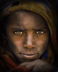 Highland Shepherd boy (liesbet_sanders) Tags: 2017 ethiopië simienmountains northernethiopia africa eastafrica boy face eyes closeup harshness outside outdoors daytime black