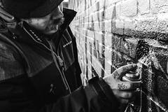 The Graffiti Artist (raymorgan4) Tags: graffiti artist wallart urban spray paint fujifilm fujifilmx100f acros blackandwhite monochrome cardiff welsh art artwork city tattoo finger hand moustache x100f dare2b