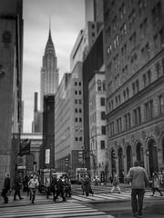 On the Move (ginoNYC) Tags: citylife newyorkcity nyc newyork manhattan empirestatebuilding esb skyscrapers lunchbreak midtownmanhattan blackandwhite bnw