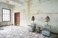 W State Hospital (Jonnie Lynn Lace) Tags: abandoned abandonedamerica vacant ruins derelict decay paintchips abandonedchair light dark sunlight yellow orange red blue green golden gold old nikkor nikon flickr urbex hospital abandonedhospital white day daylight nautrallight indoors interior indoor bright chair seat statehospital 25mm digital classic inside peelingpaint door window perspective detail details texture textures usa unitedstates