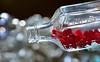 Macro Monday ~  In a Bottle (Karen McQuilkin) Tags: cinnamon hearts candy cinnamonheartscandy bottle macromondays antiquepharmacybottle redhots