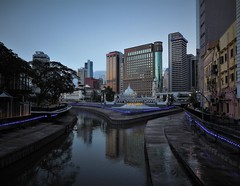 Where it all started (SM Tham) Tags: asia southeastasia malaysia kualalumpur city cityscape river water reflections embankment walkway buildings masjidjamek mosque trees sky evening dusk lights skyline klangriver gombakriver confluence