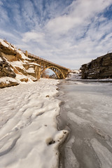 Divided (Kristin Repsher) Tags: alberta bridge canada canadianrockies lundbreckfalls pinchercreek rockies rockymountains snow waterfall winter ca