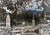 the towers of Salzburg (SM Tham) Tags: europe austria salzburg kapuzinerberg viewpoint cityscape buildings church towers landscape tree leaves clouds mist