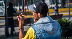 2018 - Mexico City - The Shaver (Ted's photos - For Me & You) Tags: 2018 cdmx cityofmexico cropped mexico mexicocity nikon nikond750 nikonfx tedmcgrath tedsphotos tedsphotosmexico vignetting bokeh man mirrot reflection ballcap hoodie vest male bracelet ear dof hat shadow blue