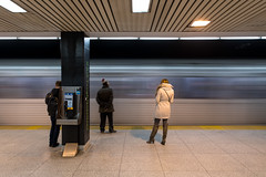 Light Speed (cookedphotos) Tags: 2018inpictures toronto ontario canada canon 5dmarkiv streetphotography ttc subway waiting timelapse woman white coat stgeorge platform 365project p3652018