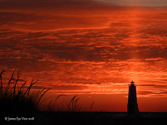 Lighthouse Pillar (JamesEyeViewPhotography) Tags: frankfort lighthouse sunset lakemichigan greatlakes sky clouds beach grass water waves winter nature landscape january lake michigan jameseyeviewphotography