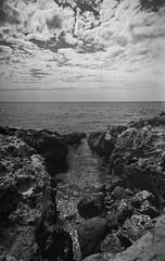 Rocky inlet (Joshua Perera Photography) Tags: kodak 5302 expired rocks seascape clouds sky minolta x700 water sea 21mm f28 beach ocean home dev develop developed development stand rodinal epson 4990