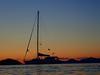 sunset behind Wishing Star II (Jwaan) Tags: wishingstarii sunset sailboat orange blue black yellow water caribbean ocean westindies britishvirginislands bvi