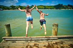 Pahi Beach 082 (C & R Driver-Burgess) Tags: teen young boy girls leap jump harbour wharf sea kaipara brother sister girlfriend nephew niece son daughter shorts halter top green blue clear sky sunny summer splash