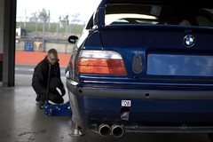 BMW M3 (E36) being prepared for the track (Take Photos, Maybe) Tags: track car race circuit garage mechanic exhaust rear view bmw m3 e36