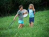 Visit to the MC family 26 (C & R Driver-Burgess) Tags: boys fight play fantasy medieval knights warrior sword shield two three field trees paddock bare feet long curly blonde hair friends preteen young farm grass green fun adventure