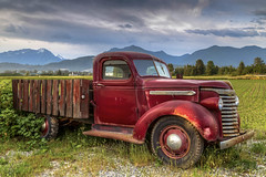 Retired (Paul Rioux) Tags: old vehicle flatdeck truck vintage decayed decaying decay rust rusty rusting patina farm agriculture agricultural chilliwack bc rural country prioux generalmotors mountains clouds gmc