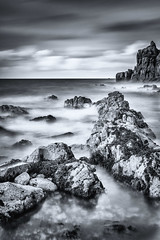 Cobo Bay: Guernsey, Channel Islands (David Claringbold) Tags: lightroom raw nikon d750 tamron2470 silver efex pro black white mono guernsey channelisland uk england beach ocean water wet landscape dramatic atmosphere atmospheric rocks stone stones cliffs waves clouds clarity portait view hue seaweed moving blur detail evening dusk goldenhour bluehour bay cobo milky milk smooth crystal transparent froth rule thirds tide