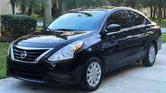 Happiness is a freshly washed car (Lee Bennett) Tags: black wash clean versa nissan automobile car